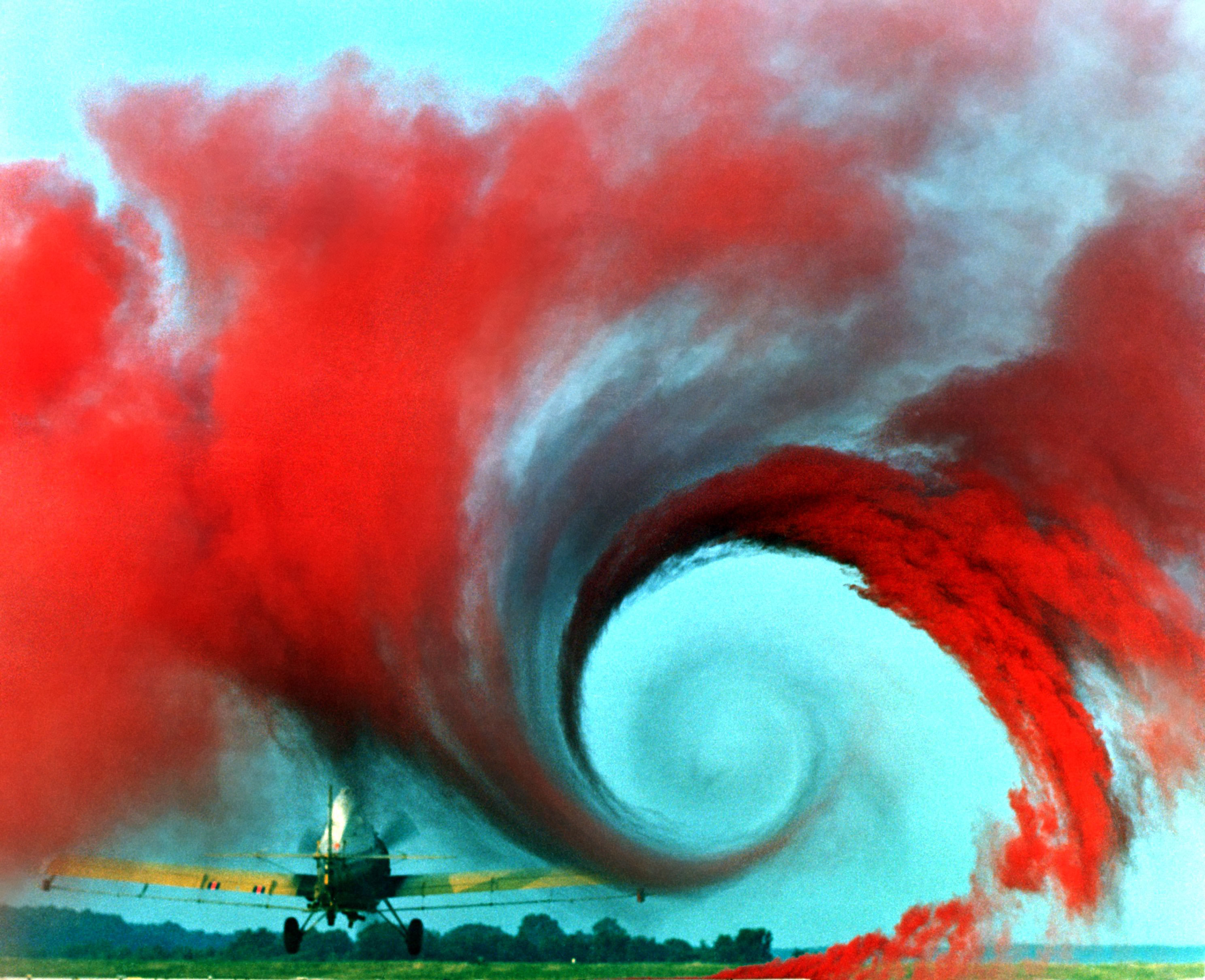 Red powder is used to trace the eddy created by an airplane wing