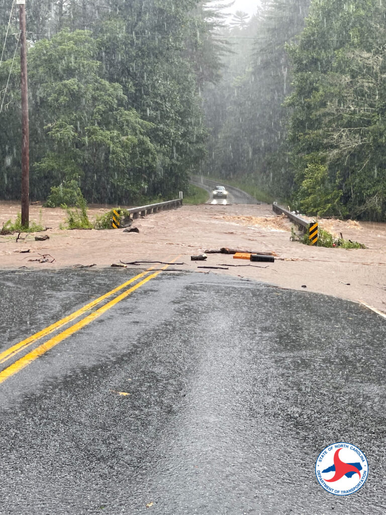 A photo of a flooded bridge in Canton, NC