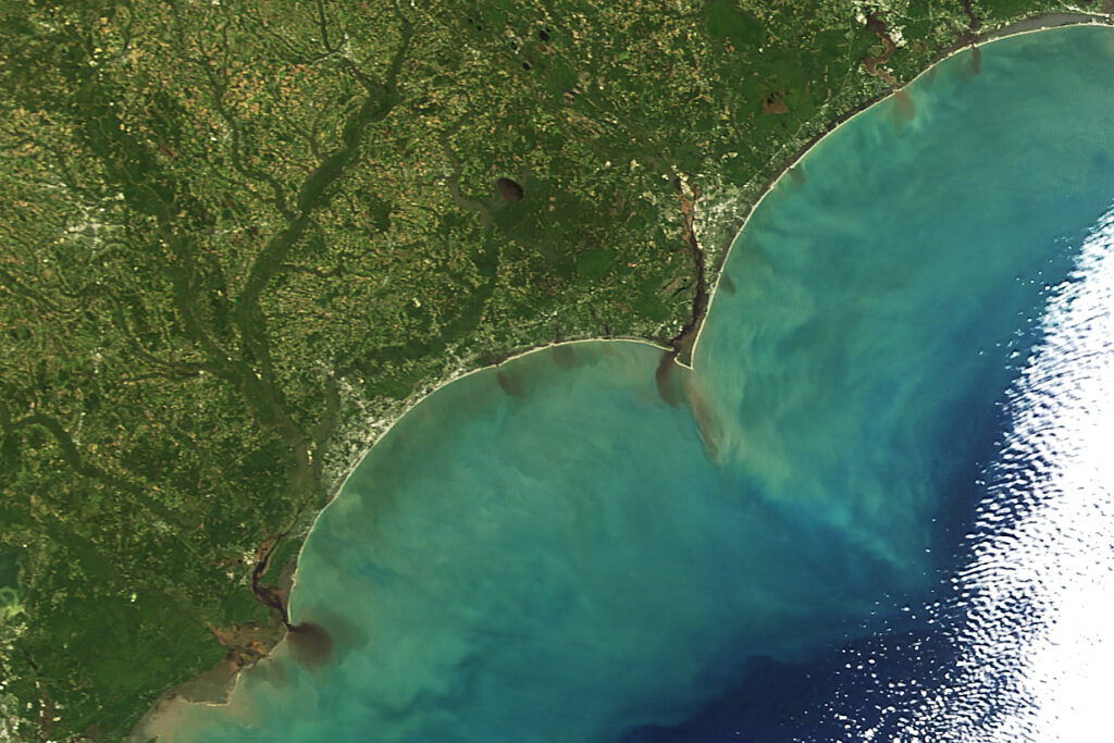 A satellite image of sediment from the Cape Fear River reaching the Atlantic Ocean