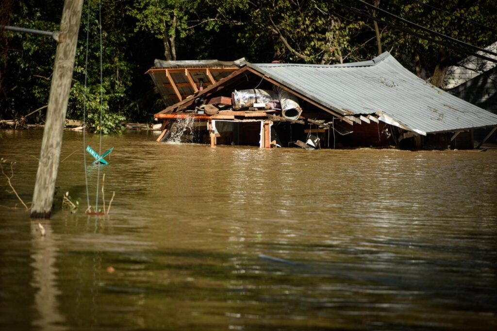 A photo of a flooded mill building near Fayetteville